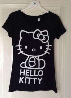 A vendre sur #vintedfrance ! http://www.vinted.fr/mode-femmes/t-shirts/16772656-tee-shirt-noir-et-blanc-hello-kitty