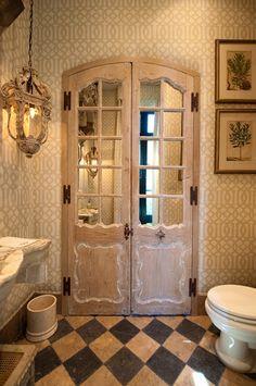 Mirrored bathroom door, love the use of tiles