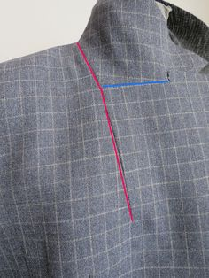 Dart under the lapel. It helps the lapel (front facing) roll properly over the under collar (jacket front).  Found on: http://kaythesewinglawyer.blogspot.com/2014_03_01_archive.html