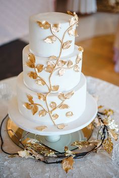 Denise Keller's wedding cake was a vanilla and cream confection with fondant and edible gold leaves.