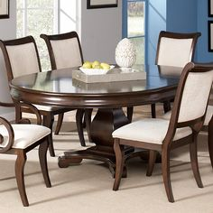 This beautiful pedestal Harris Dining Table by Coaster Furniture will be a lovely addition to your semi-formal dining room. The piece carries a deep rich cherry finish and is made from poplar solids and cherry veneers. The smooth table top features a convenient leaf so the length can be extended from 54 to 74 inches, allowing you to easily accommodate guests. Make your dining room complete with help from this single pedestal table.
