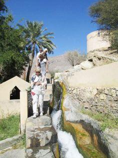 Oman | Tourists at Aflaj Irrigation Systems (Unesco WHS), Birkat Al Mouz. credit: Bike and Hike Oman.
