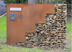 gabion and corten, great combo. This river rock gabion and corten steel for house numbers and mail is in Melbourne, Australia. Photo by Virginia Blue. Steel Retaining Wall, Gabion Wall, Retaining Walls, Steel Fence, Gabion Fence, Steel Wall, Fencing, Landscape Architecture, Landscape Design