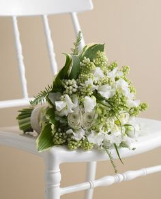 White  Green bridal bouquet // Photo: Philip Ficks