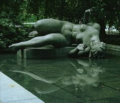 Sculpture by Aristide Maillol of his muse Dina Vierny, displayed on the ledge of a pond in the garden of the Museum of Modern Art, New York