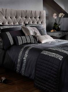 This sophisticated black satin effect bed linen from Kylie features silver sequin stripes to add a sparkling touch to your bedroom. Upholstered headboard.