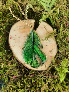 Green pendant in the shape of feather made of antiallergic metal, Original pendant, inspired by nature, Clothes accessories