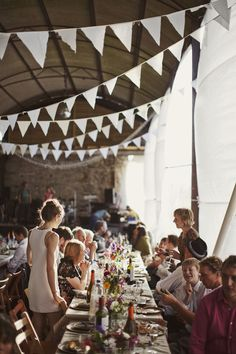 Way cool venue and loving the raw cut strings of white fabric banners. So simple yet such an impact!
