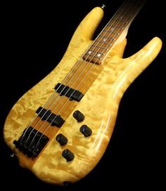 1994 Ken Smith BSR Burner Electric Bass Guitar Natural with a Golden look: RESEARCH DdO:) - https://www.pinterest.com/claxtonw/bass-foundation/ - BASS FOUNDATION. 24-fret Rosewood fingerboard tops 5 piece Maple neck for amazing looks, fast feel. 3 piece Ash and Quilt Maple body is a Natural finish so the beautiful figuring can shine through. Dual Ken Smith J-style pickups are wired to a blend control, then to a USA Ken Smith active pre-amp with two-band EQ. The black hardware compl
