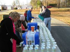 Hundreds of cups of water and Gatorade were prepared for Roanoke Canal Half-Marathon/8K runners at a refreshment station outside of the Roanoke Canal Museum. The station was staffed with volunteers from First Christian Church.