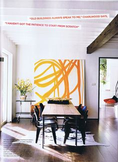 Light. beam. pop of color. wide plank wood floors. rustic table. From Vogue Living.