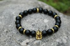 Men black stretch beaded bracelet with     gladiator spartan gold helmet Micro Pave Cubic Zirconia   Approx. 10mm black matte polish glass beads         Payment  Please make a payment through PayPal.    Shipping  Free shipping  Items ship within 24 hours of receiving cleared payment (Exceptions on Saturday,Sunday,Holiday).    Contact us  If you have any question of our products, please feel free to contact us. Thank you for looking.  | eBay!
