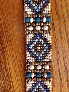 This Would Look Great With Jeans and Boots!!!! Sundance, Country, Western Style. Hand Loomed with Glass Faceted Czech Beads, Picasso Seed Beads, Give this Bracelet Lots of Texture. Denim Blues, Woodsy Browns, Creams, a Touch of Gold for a Little Sparkle. Leather End Tabs Beautiful Bronze Flowered Button Closure. Use Zoom Under Photos to See Detail. Quality Made Durable. Measures 7 1/2 inches in length Width-15/16 inch. Almost an inch. This is not adjustable. Ships USPS FIRST CLASS  Ready…