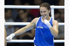 Canada's Mandy Bujold is all smiles after winning her semifinal bout on Tuesday at the Pan Am boxing venue in Oshawa.