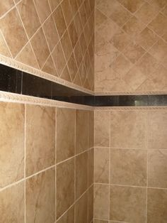 Shower Tile ideas for bathroom remodel - I like the two different directions of tile here.....maybe the diamond tiles as a layer in middle?