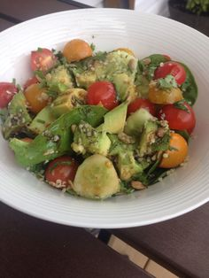Spinach and avocado salad.  Garden tomatoes, cucumbers and fresh herbs. Sprinkled with sunflower seeds and hemp hearts.