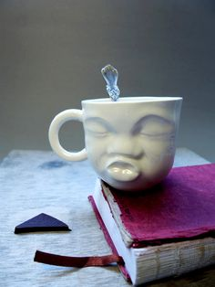 Check out this item in my Etsy shop https://www.etsy.com/ru/listing/173958973/porcelain-cup-kissing-face-sculpture
