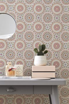 Influenced by tiles and mosaic patterns, this beautiful wallpaper design features a bohemian style circular floral pattern in lovely, warm lively colours.