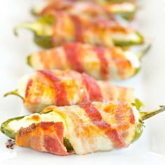Jalapeno Poppers - A classic! Just three ingredients and super easy - halved, seeded jalapeños are stuffed with cream cheese and wrapped with bacon. Appetizer Recipes, Appetizers, Keto Recipes, Keto Desserts, Cheese Recipes, Yummy Recipes, Snack Recipes, Bacon Wrapped Jalapenos