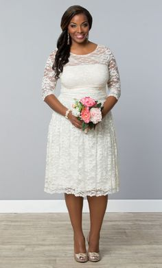 Short and sweet is the way to go for a low key intimate wedding.  For that we recommend our plus size Aurora Lace Wedding Dress.  Beautiful allover lace and a stunning illusion neckline leaves you feeling confident and comfortable.  Browse our entire made in the USA collection and other bridal styles online at www.kiyonna.com.  #KiyonnaPlusYou