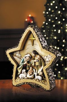 "Star Shaped Woodgrain Christmas Nativity Scene. Rustic and traditional nativity Christmas decoration. Measures at 8. 5"" W x 8"" H Made of resin Avalon Gallery Collection"