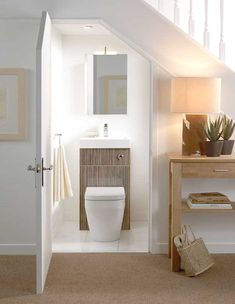 Did you know you could turn an under stairs space into a small bathroom? Just install a cute toilet sink combo and add a mirror above it. Small Downstairs Toilet, Small Basement Bathroom, Bathroom Cost, Small Toilet Room, Tiny Bathrooms, Bathroom Layout, Bathroom Interior Design, Bathroom Ideas, Downstairs Bathroom
