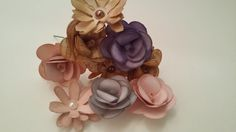***BESPOKE*** Rustic paper flowers made in any colour of your choice perfect for decorating wedding cakes or for bridesmaids hair. These can be added to slides for your hair or attached to fascinators the choices are endless! £2 Each
