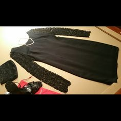 """Ann Taylor, wore 1x, EUC This elegant Anne Taylor Studio black dress is lined & has an open embroidered pattern on the sleeves.  The back has a 5.5"""" kick pleat.  70% acetate, 30% poly.  14"""" across shoulders, 38"""" shoulder to hem, almost 26"""" long sleeves, v-neck in back of dress extends down 11"""" at which point an 11"""" hidden zipper begins.  Excellent condition, worn once. Ann Taylor Dresses Long Sleeve"""