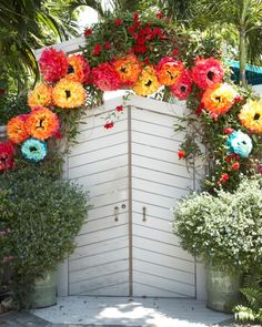 Nathan and Sky wanted to incorporate bright tissue-paper flowers, which Sky's mother had taught him to make as a young child, into their wedding décor. The vibrant blooms adorned the doorway that served as a backdrop for their ceremony.