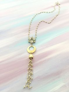 """By Your Mercy"" - 1950's rhinestone brooch paired with antique gold hammered brass pendant and a pyrite beaded tassel"