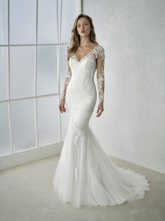 FEDRA Sensual long sleeve mermaid wedding dress in embroidered tulle with guipure appliqués. A V-neck dress that hugs the body with a corset effect created by lacing on the back. A very elegant dress with a very sexy touch. Pret de lista http://www.sanpatrick.com/ro/wedding-dresses/fedra-long-sleeves.html In magazin pot exista promotii   FEDRA