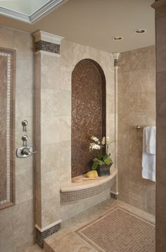 dave loves this shower and the idea of tile on all the walls of the bathroom - i like the tiny mosaic tiles as well especially when there is a shine