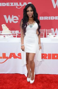 Nicole Polizzi wearing a beautiful white dress to fit her length.