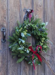 love this fresh fir, eucalyptus and pheasant feather christmas wreath by Pod & Pip. Click through for more beautiful and simple to make ideas for your own christmas wreaths. Homemade Christmas Wreaths, Homemade Wreaths, Xmas Wreaths, Christmas Crafts, Christmas Decorations, Holiday Decor, Flower Wreaths, Winter Wreaths, Christmas Christmas