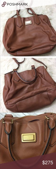 """Marc by Marc Jacobs Cognac Large bag Marc Jacobs large cognac bag. Lining is a purplish wine color. Bag is in good condition aside from some minor scratches. Handles & hardware are still in good condition but does have some light scuffing, normal wear, but no major flaws noted. Inside is fairly clean, does have some light staining from hair oil that spilled inside, no odors. Purchased bag from Nordstrom for $498. 16.5"""" in length, 12"""" height, 7"""" depth, 8"""" top handle, 17"""" shoulder handle drop…"""