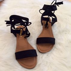 Black Tassel & Ankle Tie Sandals 8 Size 8! Black Faux Suede Sandal. Ankle Tie with Tassel Detail. Fit true to size. Faux Suede. Faux Leather. Come brand new in box. Available in 6, 6.5, 7, 7.5, 8, 8.5, 9, & 10. One of each size available. Bundle for 15% discount on 3+ items. Only offers made through the offer button with be considered. Thank you! Boutique Shoes Sandals