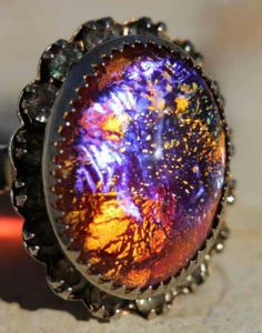 Dragons breath opal ring. Neat. I wouldn't where it though.