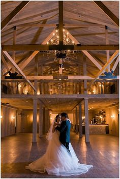 Rustic Manor was built from the ground up with weddings in mind. It's a great barn wedding venue in the Milwaukee area. Photo by Elizabeth Haase / Tara Keely dress from Bliss Bridal