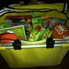 Road trip basket for kids!! All from Target: Vinyl picnic basket, DVDs, kids music, wet ones, broom/dust pan, goldfish crackers, juice boxes, small toys! Voila!!