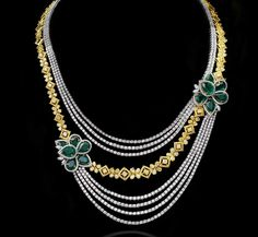 A gorgeous asymmetric diamond necklace rendered in emeralds by Mahesh Notandass previewed by WeddingSutra.