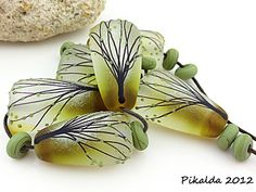 Lampwork beads, beautiful lines of branches, love the glass blend of the base bead.