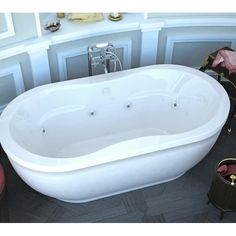 Features:  -Fiberglass reinforced acrylic tub with removable acrylic shell piece.  -High gloss white finish with matching jet faces and buttons.  -Interior of tub is oval shape; tub is freestanding.