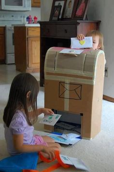 Re-use old cardboard boxes for play time. Example mail box pic - another cool way to #reuse cardboard & keep the kids entertained!