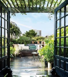 Pergola French doors open onto a lush rooftop garden outfitted with bistro chairs by Fermob at hairstylist Guido Palau's artful Manhattan duplex. Outdoor Seating Areas, Outdoor Rooms, Outdoor Living, Indoor Outdoor, Outdoor Decor, Celebrity Houses, Architectural Digest, French Doors, French Windows