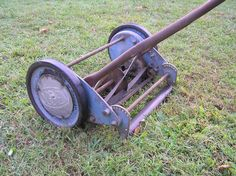 Old Push Cylinder Lawn Mower gave us exercise while cutting the grass.