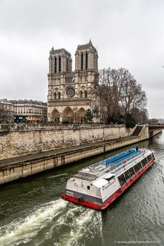 A boat in front of the Notre Dame in Paris, France. Click through for more pictures on the A Lady in London blog.   #paris #france #notredame #boat