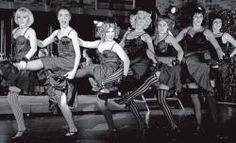 """From the Thousand Oaks Acorn: HIGH STEPPIN'—Michael Seltzer as the Emcee dances with the Kit Kat Klub girls in the song """"Kickline"""" from the musical """"Cabaret,"""" playing through Sunday at the Thousand Oaks Civic Arts Plaza."""