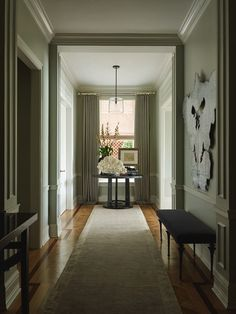 Entry Hall | Slight insteps on hallway to avoid long-run crown moulding pieced together | Villalobos Desio