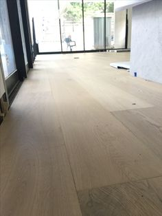 Royal Oak 2400 White Smoked Oak Floorboards in today. Love. Looking great against full height windows and Carrera Marble bench