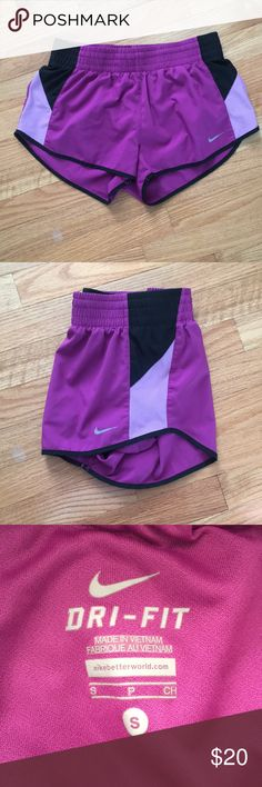 Women's purple Nike dri-fit shorts (norts) Purple center with light purple on the bottom half of the side stripe, top of the stipe is black, black trim, worn once Nike Shorts